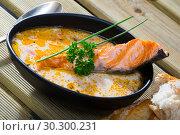 Купить «Salmon cream soup with bread», фото № 30300231, снято 17 сентября 2019 г. (c) Яков Филимонов / Фотобанк Лори