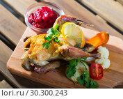 Купить «Poultry dish with cranberry sauce», фото № 30300243, снято 25 мая 2019 г. (c) Яков Филимонов / Фотобанк Лори