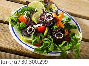 Купить «Blood sausage with greens», фото № 30300299, снято 25 августа 2018 г. (c) Яков Филимонов / Фотобанк Лори