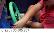 Small hands child quickly twist wheel car. Стоковое видео, видеограф Ekaterina Demidova / Фотобанк Лори