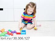 Купить «Lovely little girl playing with educational toy at home», фото № 30306127, снято 14 февраля 2019 г. (c) ivolodina / Фотобанк Лори