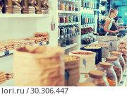 Купить «Illustration of showcase with dried fruits and nuts in bag», фото № 30306447, снято 4 сентября 2017 г. (c) Яков Филимонов / Фотобанк Лори