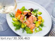 Купить «Tasty seafood ceviche from salmon with avocado, green dill and cumquat», фото № 30306463, снято 19 апреля 2019 г. (c) Яков Филимонов / Фотобанк Лори