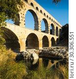 Купить «Famous landmark Roman Bridge Pont du Gard in southern France», фото № 30306551, снято 8 декабря 2017 г. (c) Яков Филимонов / Фотобанк Лори