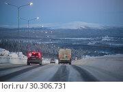 Купить «MURMANSK, RUSSIA - FEBRUARY 21, 2019: Winter evening on the Kola highway. Surroundings of Murmansk», фото № 30306731, снято 21 февраля 2019 г. (c) Виктор Карасев / Фотобанк Лори