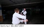 Купить «Two young men in kimono training their skills in martial arts. Sword fight», видеоролик № 30307051, снято 8 июля 2020 г. (c) Константин Шишкин / Фотобанк Лори