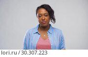 Купить «happy african american woman having interview», видеоролик № 30307223, снято 10 марта 2019 г. (c) Syda Productions / Фотобанк Лори