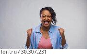 Купить «happy african american woman celebrating success», видеоролик № 30307231, снято 10 марта 2019 г. (c) Syda Productions / Фотобанк Лори