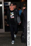 Купить «Joe Walsh arrives at Los Angeles International Airport (LAX) with his wife, Marjorie Bach Featuring: Joe Walsh, Marjorie Bach Where: Los Angeles, California...», фото № 30309375, снято 13 сентября 2017 г. (c) age Fotostock / Фотобанк Лори
