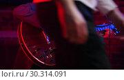 Купить «A young woman playing guitar and singing song in neon lighting», видеоролик № 30314091, снято 23 марта 2019 г. (c) Константин Шишкин / Фотобанк Лори