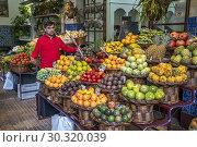 Купить «Fruits stall at the market hall Mercado dos Lavradores, Funchal, Madeira, Portugal, Europe.», фото № 30320039, снято 15 февраля 2019 г. (c) age Fotostock / Фотобанк Лори
