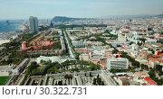 Купить «Modern cityscape of Barcelona on background with water surface of Mediterranean», видеоролик № 30322731, снято 23 июля 2018 г. (c) Яков Филимонов / Фотобанк Лори