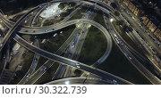 Купить «Aerial view of modern city highway grade separation in night lights», видеоролик № 30322739, снято 26 октября 2018 г. (c) Яков Филимонов / Фотобанк Лори