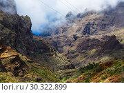 Купить «Fabulous Masca mountain gorge the most visited tourist attraction on Tenerife», фото № 30322899, снято 13 сентября 2015 г. (c) Ирина Мойсеева / Фотобанк Лори