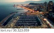 Купить «Landscape of illuminated Barceloneta Beach in summer night in Barcelona, Spain», видеоролик № 30323059, снято 28 сентября 2018 г. (c) Яков Филимонов / Фотобанк Лори