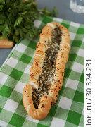 Купить «Pita bread with cheese and dill», фото № 30324231, снято 31 января 2015 г. (c) Stockphoto / Фотобанк Лори