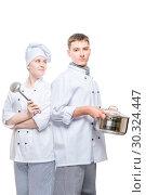 Купить «cooks in suits with a pan and a ladle posing on a white background», фото № 30324447, снято 14 октября 2018 г. (c) Константин Лабунский / Фотобанк Лори
