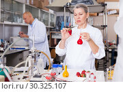 Купить «Woman biochemist checking fruits and vegetables», фото № 30325107, снято 24 января 2019 г. (c) Яков Филимонов / Фотобанк Лори