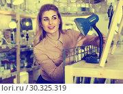 Купить «Housewife buying table lamp», фото № 30325319, снято 15 января 2018 г. (c) Яков Филимонов / Фотобанк Лори