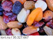 Купить «Roasted kernels of different nuts and raisins», фото № 30327667, снято 9 марта 2019 г. (c) Владимир Белобаба / Фотобанк Лори