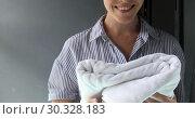 Купить «Cheerful woman holding a beautifully folded towel», видеоролик № 30328183, снято 28 февраля 2019 г. (c) Ekaterina Demidova / Фотобанк Лори