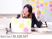 Купить «Young female employee in conflicting priorities concept», фото № 30328507, снято 21 января 2019 г. (c) Elnur / Фотобанк Лори