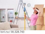 Купить «Middle-aged woman doing renovation at home», фото № 30328743, снято 27 декабря 2018 г. (c) Elnur / Фотобанк Лори