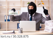 Купить «Male gangster stealing information from the office», фото № 30328875, снято 20 декабря 2018 г. (c) Elnur / Фотобанк Лори