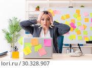 Купить «Young female employee in conflicting priorities concept», фото № 30328907, снято 19 декабря 2018 г. (c) Elnur / Фотобанк Лори