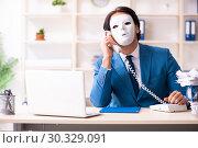 Купить «Male employee in the office in industrial espionage concept», фото № 30329091, снято 7 декабря 2018 г. (c) Elnur / Фотобанк Лори
