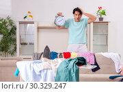 Купить «Young man husband ironing at home», фото № 30329247, снято 4 декабря 2018 г. (c) Elnur / Фотобанк Лори