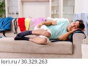 Купить «Young man husband ironing at home», фото № 30329263, снято 4 декабря 2018 г. (c) Elnur / Фотобанк Лори