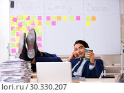 Купить «Young handsome employee in front of whiteboard with to-do list», фото № 30330207, снято 16 октября 2018 г. (c) Elnur / Фотобанк Лори