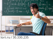 Young male student mathematician in front of chalkboard. Стоковое фото, фотограф Elnur / Фотобанк Лори