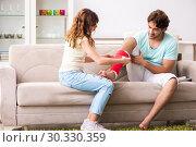 Купить «Young family helping each other after injury», фото № 30330359, снято 21 сентября 2018 г. (c) Elnur / Фотобанк Лори