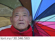 Купить «NEPAL Kunde -- Portrait of a Sherpa Tibetan Buddhist monk in Kunde in the Khumbu Himalaya in the Everest region of Nepal -- Picture by Jonathan Mitchell.», фото № 30346583, снято 15 сентября 2007 г. (c) age Fotostock / Фотобанк Лори