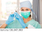 Купить «Professional nurse young woman making injection in hospital», фото № 30347383, снято 1 мая 2018 г. (c) Яков Филимонов / Фотобанк Лори