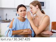 Купить «Girl telling her friend bad news», фото № 30347435, снято 29 августа 2018 г. (c) Яков Филимонов / Фотобанк Лори