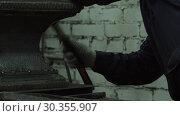 The Hands Of A Blacksmith Man Are Hammering An Iron Piece. Стоковое видео, видеограф Pavel Biryukov / Фотобанк Лори