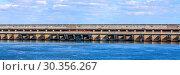 Купить «Saratovskaya HPP (Leninsky Komsomol) - a hydroelectric power station on the Volga River in the Saratov region, in the town of Balakovo.», фото № 30356267, снято 10 сентября 2010 г. (c) Акиньшин Владимир / Фотобанк Лори