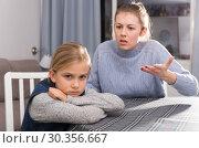 Купить «Woman scolding her daughter», фото № 30356667, снято 22 января 2019 г. (c) Яков Филимонов / Фотобанк Лори
