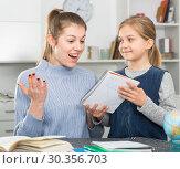Купить «Happy mother rejoices beautiful drawings of her daughter», фото № 30356703, снято 22 января 2019 г. (c) Яков Филимонов / Фотобанк Лори
