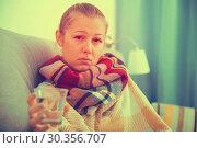 Купить «Girl in a plaid is ill of virus», фото № 30356707, снято 4 октября 2017 г. (c) Яков Филимонов / Фотобанк Лори