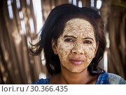 Купить «Woman with traditional face mask, in Morondava, Madagascar, Africa.», фото № 30366435, снято 23 мая 2019 г. (c) age Fotostock / Фотобанк Лори