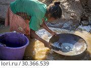 Купить «Girl miss school to pan for gold in the mountains near Ankavandra, Madagascar.», фото № 30366539, снято 24 июня 2019 г. (c) age Fotostock / Фотобанк Лори
