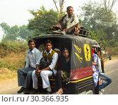 Купить «The people of India go by transport», фото № 30366935, снято 16 ноября 2012 г. (c) Игорь Жоров / Фотобанк Лори