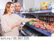 Купить «Couple choosing candies in store», фото № 30367335, снято 11 апреля 2018 г. (c) Яков Филимонов / Фотобанк Лори