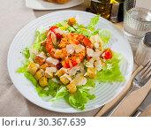 Купить «Caesar salad with grilled chicken on a white plate», фото № 30367639, снято 19 июля 2019 г. (c) Яков Филимонов / Фотобанк Лори