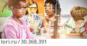 Купить «Kids doing a chemical experiment in laboratory», фото № 30368391, снято 11 июля 2020 г. (c) Wavebreak Media / Фотобанк Лори