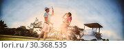 Купить «Full length of golf player couple giving high five», фото № 30368535, снято 22 мая 2019 г. (c) Wavebreak Media / Фотобанк Лори